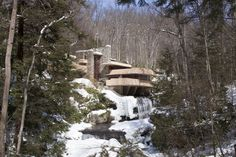 See Frank Lloyd Wright's Falling Water.  This one is actually already checked off my personal list.  Visited with my best friend in 2010