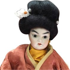 This little Geisha girl has a beautiful face with especially nice feathered brows. Antique Schoenhau Hoffmeister 4900 Asian Doll