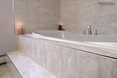 Bathroom remodel by Renovisions. Contemporary style, jacuzzi tub, tiled steps, metal trim, chrome fixtures
