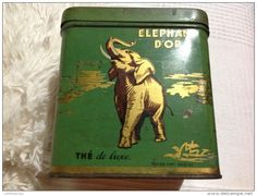 Elephant D'Or [Golden Elephant] tea tin ... decorated with gold elephant on green tin, mid 20th century, French?