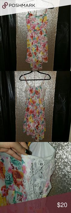 NWT forever 21 floral high low chiffon dress NWT floral high low chiffon dress. This dress is perfect for summer! Each side sling the rib cage has a sheer lace panel that gives this dress a little extra sass! Great deal for a new dress! Length 34/42 high/low, and bust 34' Forever 21 Dresses High Low