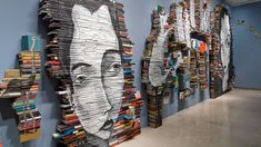 This is rather crazy. Using stacked spines of books as a canvas. Hopefully they are crummy books.