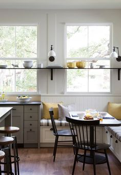 this is what I wanted to do in my kitchen. The shelf, the banquette shelf, the lighting, the chairs. But I didn't.