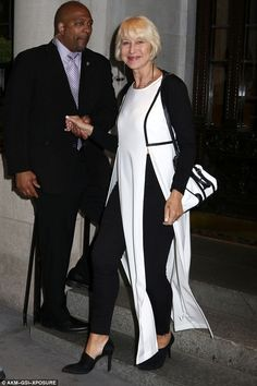 Elegant: The Queen actress looked stylish in a long black and white shirt dress with waist-high slits, matched with black trousers