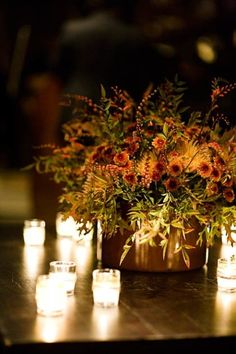 gorgeous fall centerpiece with votives....