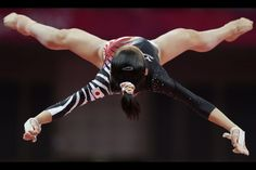 Women's Uneven Bars  Japanese gymnast Yu Minobe performs on the uneven bars during the artistic gymnastics women's qualifications at the 2012 Summer Olympics, Sunday, July 29, 2012, in London.