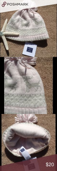 Knit Reindeer Baby Beanie This adorable beanie features a knit reindeer outer, and a soft comfy soft cotton inside lining. Off white and light green in color. Pom Pom feature on the top. Gender neutral. Machine wash. Janie and Jack Accessories Hats