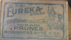 This listing is for a wonderful, wood fruit box from Eureka Brand, Santa Clara Prunes from California. Not only does it have the Eureka label embossed into one side, the remaining three sides also have printing as seen in the photos. What a great piece of history!! Perfect for decorating - big, yet small enough to be used as a centerpiece, planter, candle holder, etc. So many possibilities - perfect for books and a throw blanket next to the bed or sofa or use it in the kitchen as part of a…
