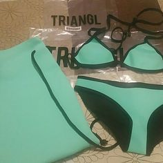 Triangl neoprene swim suit with Bag New!! Color: Miami Mint   Top string triangl small Bottoms small  Comes with signature neoprene bag triangl swimwear Swim Bikinis
