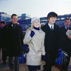 """Today 1-16 in 1965: Beatles manager Brian Epstein, in Britain's Melody Maker magazine, is quoted as saying """"I give the Beatles two or three years more at the top."""" Photo is of Cyn Lennon with John on the tarmac at London's Hethrow airport -- Brian following and hordes of fans lined up on the upper deck to catch a glimpse."""