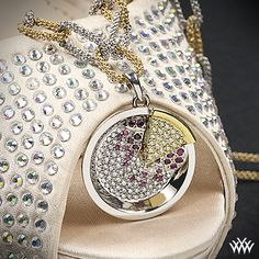 """Serving up a slice of sparkle pie! """"Sparkle Pie"""" Diamond Pendant. Not one detail has been overlooked in this utterly unique masterpiece. Sprinkled with 91 A CUT ABOVE® Hearts and Arrows Diamond Melee (0.70ctw; F/G VS) and 16 Rubies (0.20ctw) this pendant will always be the topic of conversation. The combination of the platinum pie plate and the 18k yellow gold slice of pie is sure to leave you with a smile.   Who wants a slice?"""