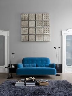 Admirable Blue Sofa Designs For Fascinating Living Room With Nice Backrest And Dice Box Shaped Wall Ornament Also Round Desk Lamp