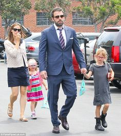 Ben Affleck and Jennifer Garner and their two daughters headed off to church in West Virginia on Sunday for the baptism of the couple's son Samuel in Charleston, West Virginia.