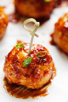 The best way to eat chicken meatballs. These are dipped in delicious homemade Hawaiian BBQ sauce. Baked not fried so they're healthy and ideal for game day!