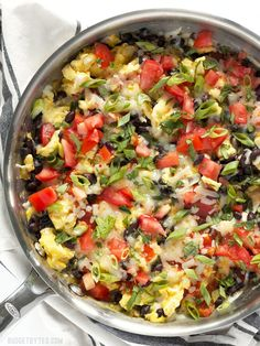 Ultimate Southwest Scrambled Eggs make a fast and filling dinner or brunch, and are a great way to use up leftover ingredients in the kitchen. BudgetBytes.com