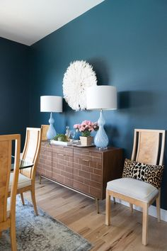 Home Decorating DIY Projects : How to Use a Juju Hat in Home Decor dark green painted walls blue lamps burl wood dining Chairs wood and gold Credenza dining room Buffet modern eclectic dining room -Read More –
