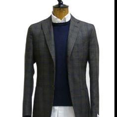 Gray blazer and blue crew neck sweater.