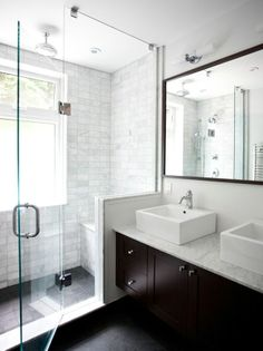 Clean   modern bath design with natural stone tile flooring. Beautiful shower!
