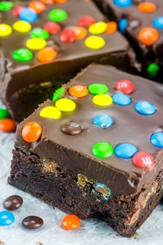 Thick, rich and delicious these M&M Fudge Brownies are overloaded with chocolate, candy and ganache making this the perfect indulgence. #brownies #chocolate