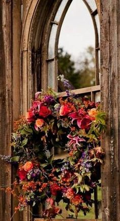 fresh wreath ispiration -yours would be with bit brighter flowers - if you did it in fresh you would not be able to keep it; however, it could be made in silk flowers to allow you to keep it.