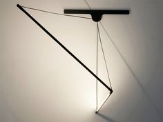 2084 is a wall lamp by French-born product designer and visual artist Geoffroy Gillant, whose design intent uses the electric cord to suspend the lamp, maintaining an equilibrium and lightness. Lamp Design, Lighting Design, Lamp Light, Light Up, Hanging Lights, Wall Lights, Futuristic Lighting, Contemporary Light Fixtures, Modular Walls
