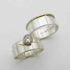 Frontera Designs creates custom wedding bands for him and her to features people's favorite mountain ranges. These rings are made in sterling silver, 14K gold and feature a half carat diamond. Heart Of The Desert, Wedding Bands For Him, Custom Wedding Rings, Ranges, Mountain, Engagement Rings, Sterling Silver, Diamond, Gold