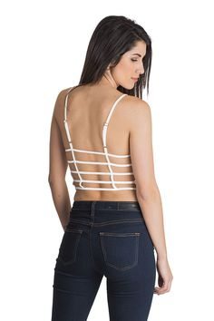 Show some skin in this white, open back, caged crop top!