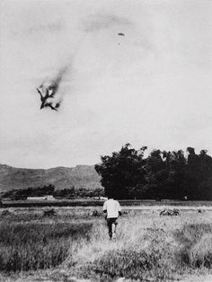 U.S. Air Force F-105 fighter-bomber is shot down. The pilot ejects and opens his parachute. This photo was taken by North Vietnamese photographer Mai Nam on September 1966 near Vinh Phuc north of Hanoi. The pilot was taken as a POW and held in a Hanoi prison from 1966 to 1973.