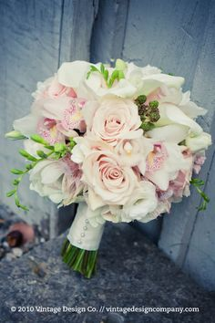 Blush tones Bouquet; this does contain orchids which can be pricey but it's a very classic look and we can always use alternate flowers in the bridesmaid bouquets