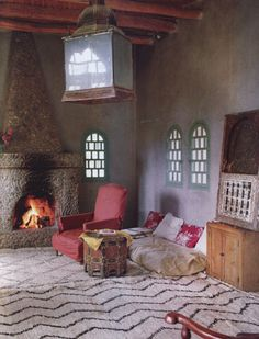 love walls, beems, fireplace, and light fixture.....feels moroccan but not overwhelmingly so!
