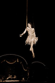 "The women is suspended by two ribbons, both giving her equal support just as the circus needed the bonfire and the tree of life to be able to maintain the illusion and the feel of ""The Night Circus""."