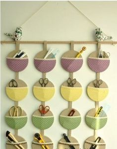 Make a hanging wall organizer with old CDs and some scraps of fabric. Very neat…