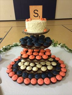Navy and coral cupcake wedding cake