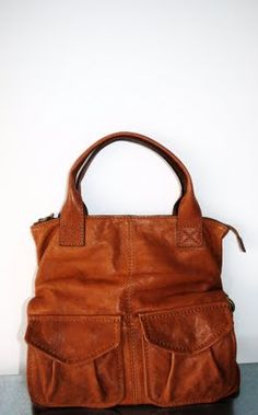 gorgeous bag. I love bags with lots of pockets,it means that you don't have to rummaging for your cell phone or tissue!