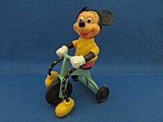 Wonderful toy from the of Mickey Mouse riding a tricycle. Toy is 4 tall and long.