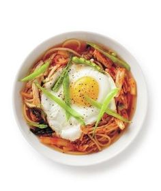 Kimchi Chicken Noodle Soup Ingredients 1/2 pound spaghetti 2 tablespoons canola oil 4 cloves garlic, sliced 3 tablespoons chopped ginger 6 cups low-sodium chicken broth 1 pound boneless, skinless chicken thighs (about 6) 1 cup sliced kimchi kosher salt 1 cup sliced snow peas, for serving 4 fried eggs
