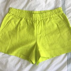 J.Crew yellow green elastic waistband shorts So bright for summer and so comfy! Small tear near pocket. 12 in long, 3 in inseam. NWT. 100% cotton. J. Crew Shorts