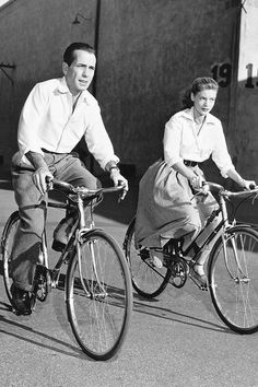 Humphrey Bogart  and Lauren Bacall, riding their bikes.