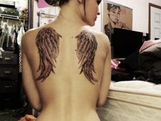 I remember being 13 years old and seeing this tattoo and wanting. Then every1 starting getting wings on their backs so I decided to be different. But will always love the tat