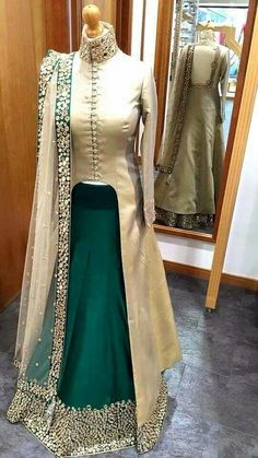 Green Silk Designer Lehenga With Long Choli Modernistic Rama Green Silk Designer Lehenga With Off White Long Choli Snazzy rama green and off white silk long choli lehenga which is classily made with pseudo mirror work. Indian Gowns, Indian Attire, Pakistani Dresses, Indian Wear, Indian Outfits, Bride Indian, Indian Lehenga, Long Choli Lehenga, Anarkali