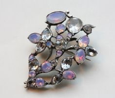 Antique Giardinetto Brooch: Georges Frederic Strass (1701-1773) invented the much desired gem imitation in 1730 and due to the huge success of the invented technique was awarded with the title King's Jeweler in 1743.