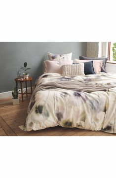 Watercolor-inspired floral patterns make this crisp cotton duvet cover a sophisticated complement to your bedroom décor.