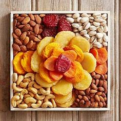 $49.99  Gourmet Fruit and Nut Rose Your gift includes:  Dried Peaches (5 oz.) Dried Jumbo Pears (7 oz.) Jumbo Almonds (3 oz.) Jumbo Cashews (3 oz.) Smoky Almonds (3 oz.) Dried Apricots (5 oz.) California Colossal Pistachios (3 oz.) Dried Ruby Red Plums (3 oz.) Wood Tray