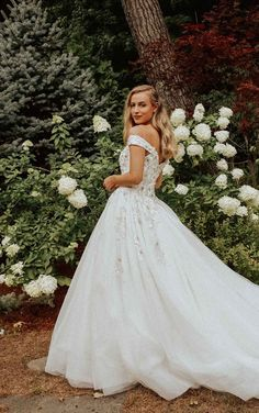 Princess ball gown wedding dress with off the shoulder strap | Essense of Australia Wedding Dresses Spring 2020 - Belle The Magazine | See more gorgeous bridal gowns by clicking on the photo