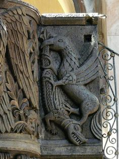 Stone carved griffin battling a.... um... not sure what that is!