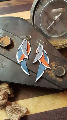 Check out this item in my Etsy shop https://www.etsy.com/listing/585169475/leather-earrings-feather-elegant-leather