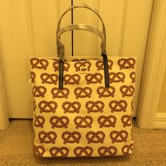 NWT Kate Spade Pretzel Tote Bag New with tags and a good size! Has compartments on the inside for your phone. Very cute. Feel free to make an offer. kate spade Bags Totes