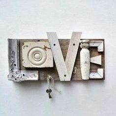 Upcycled wooden salvaged pieces spell out the word LOVE, key hook; Upcycle, recycle, salvage, diy, repurpose! For ideas and goods shop at Estate ReSale & ReDesign, Bonita Springs, FL by belinda