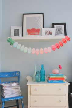 Genius DIY discovery: Paint chips cut into ovals look just like cute, striped eggs! Snag a few from a hardware store and string them together to create this (basically free) craft.  Get the tutorial at The Sweetest Digs » Easter Countdown, Easter Flower Arrangements, Easter Garland, Diy Easter Decorations, Easter Celebration, Easter Party, Paint Chips, Handmade Home, Easter Crafts