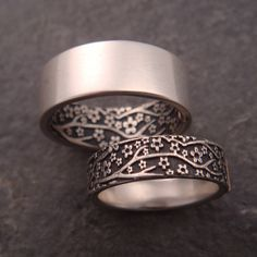 Opposites Attract Wedding Band Set -- Cherry Blossom Pattern in Sterling Silver by DownToTheWireDesigns on Etsy https://www.etsy.com/listing/215835576/opposites-attract-wedding-band-set